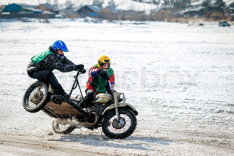 Stock image of 'Ulan-Ude, RUSSIA - January, 2014: Competitors at winter bike competition on ice.'