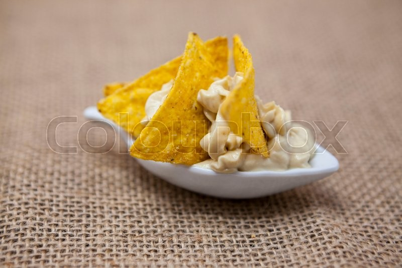 Stock image of 'Delicious Jewish hummus  with spicy red pepper chips-tapas appetizer.'