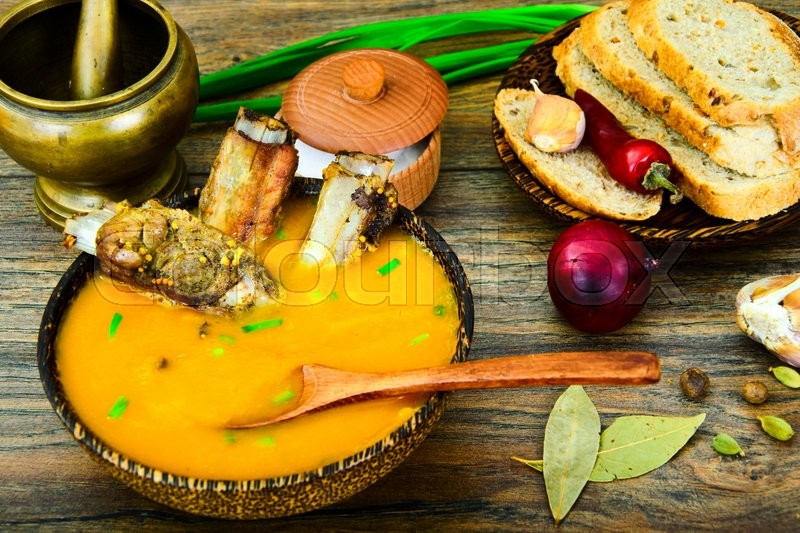 Stock image of 'Diet and Healthy Organic Food: Pumpkin Soup with Pork Ribs. Studio Photo'