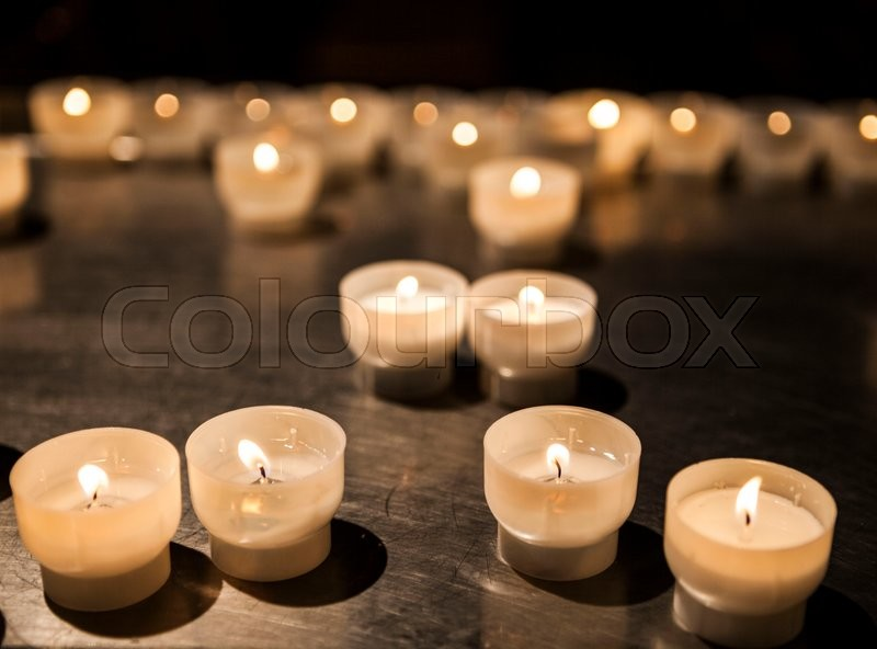 Stock image of 'Burning candles in a church close-up.'