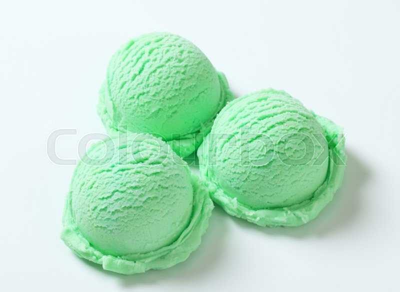 Stock image of 'Scoops of light green ice cream '