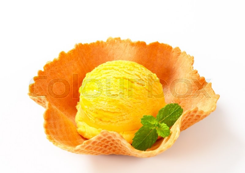 Stock image of 'Scoop of yellow ice cream in a wafer bowl'