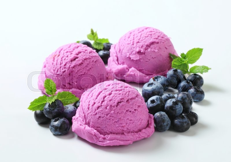 Stock image of 'Scoops of berry ice cream and fresh blueberries'