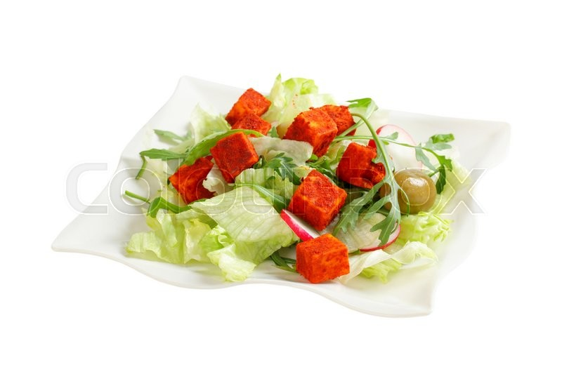 Stock image of 'Fresh vegetable salad with diced paprika-coated cheese'