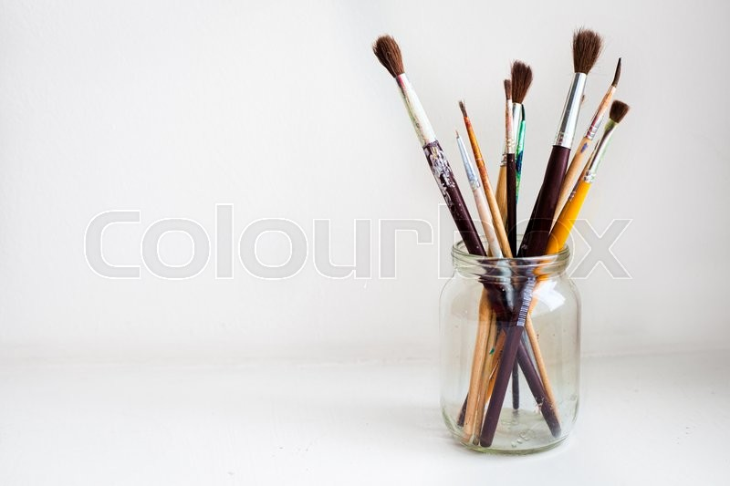 Stock image of 'Jar of Paint Brushes on white background'
