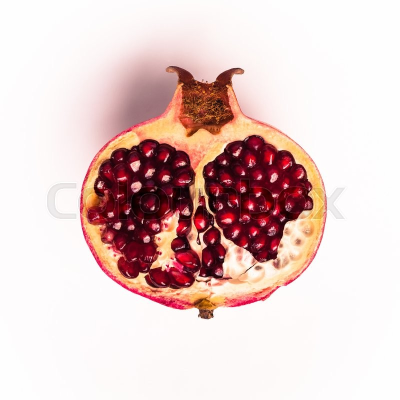 Stock image of 'Half of pomegranate on a white background'