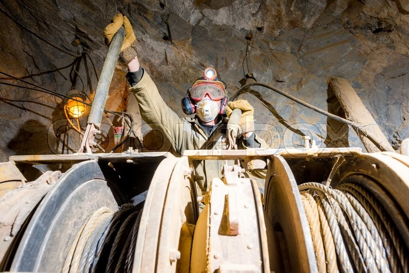 Stock image of 'Russia - August 2014: Miner poses for a photograph inside a gold mine.'