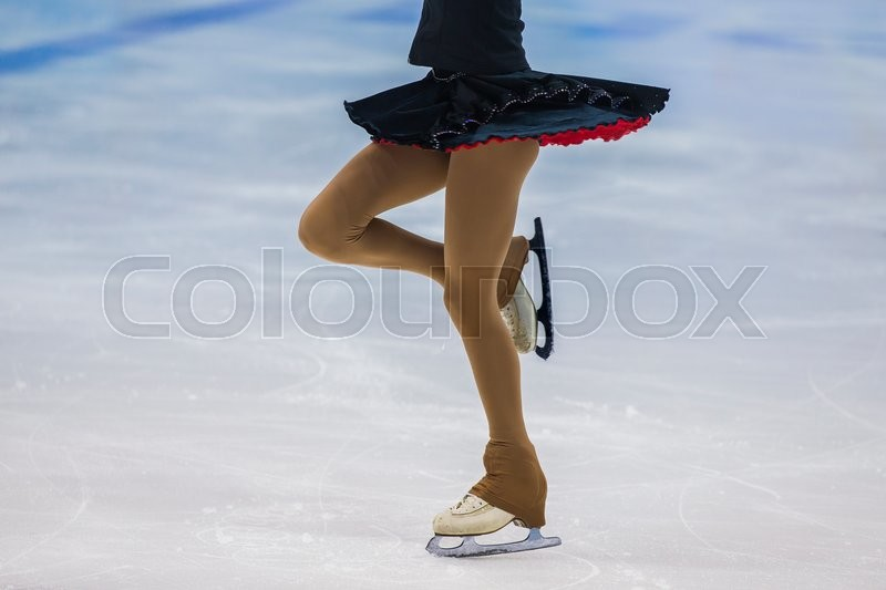 Stock image of 'closeup slender legs girls athletes figure skater. part of body, without a face'