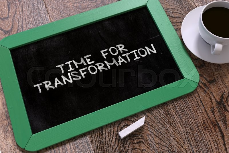 Stock image of 'Hand Drawn Time for Transformation Concept  on Small Green Chalkboard. Business Background. Top View.'