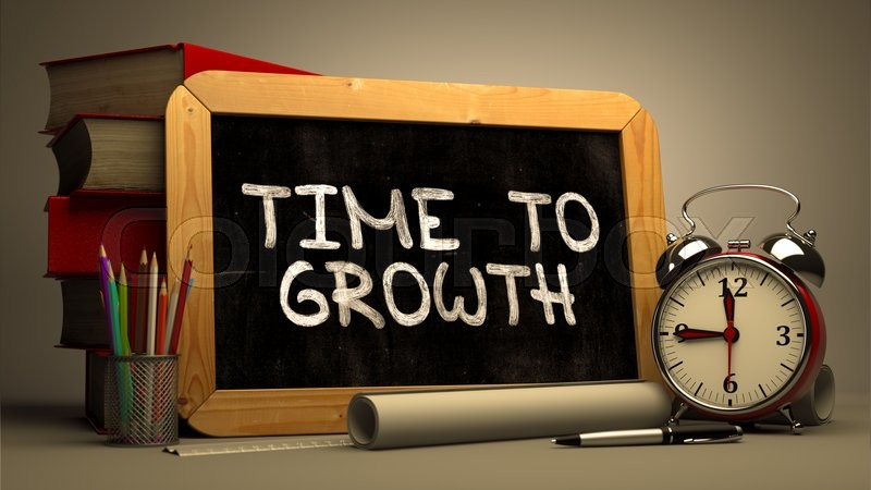 Stock image of 'Hand Drawn Time to Growth Concept  on Chalkboard. Blurred Background. Toned Image.'