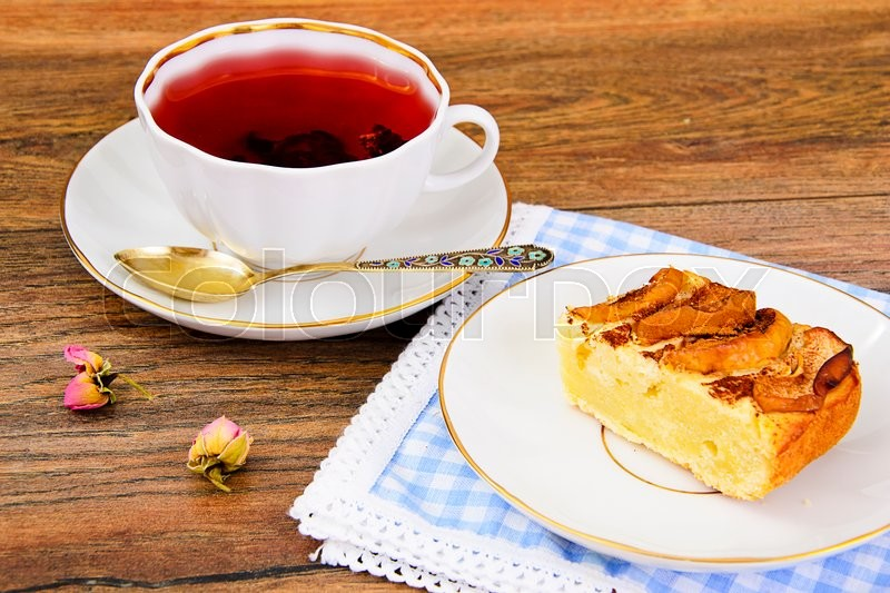 Stock image of 'Apple Pie with Tea Cup on Woody Backfround. Studio Photo'
