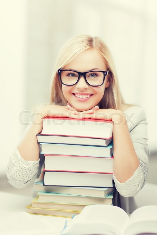 Stock image of 'picture of smiling student with stack of books'