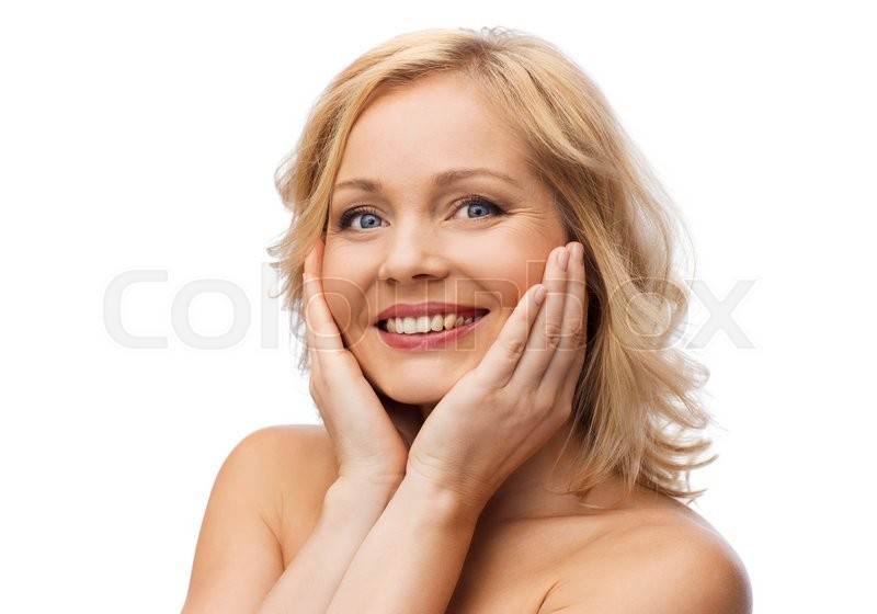 Stock image of 'beauty, people and skincare concept - smiling woman with bare shoulders touching face'