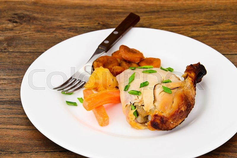 Stock image of 'Chicken Ham, Baked with Dried Apricots, Apples and Carrots Studio Photo'