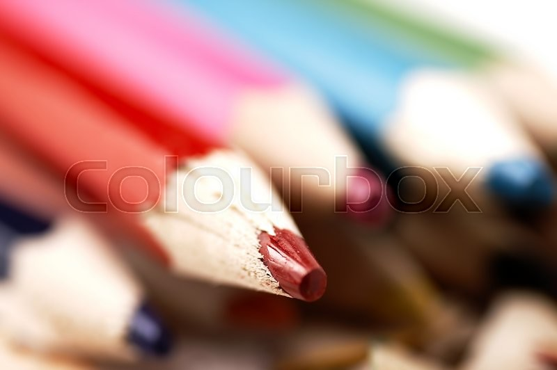 Stock image of 'Colorful wooden pencils. Selective focus. Artistic mess on the table.'