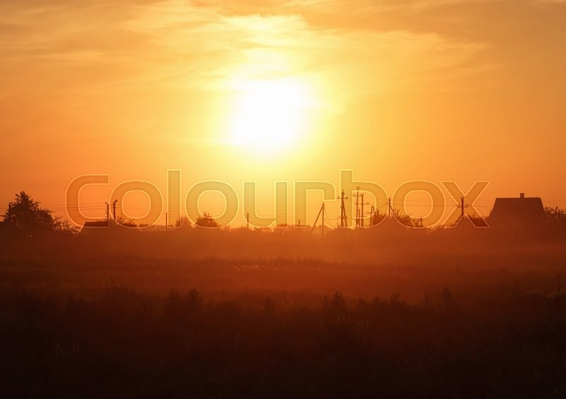 Stock image of 'Orange sunset in the countryside. Scenic rural landscape. Toned image.'