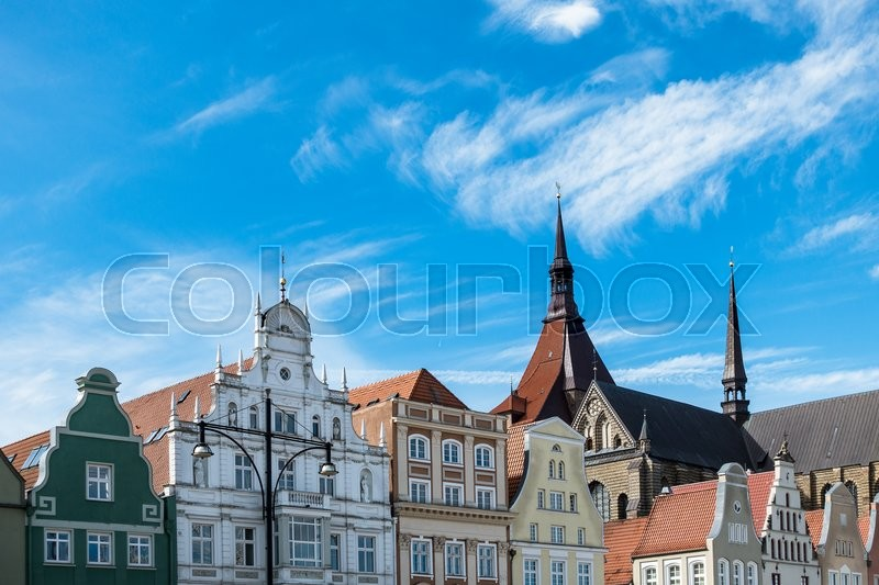 Stock image of 'Historical buildings in Rostock (Germany) with blue sky.'