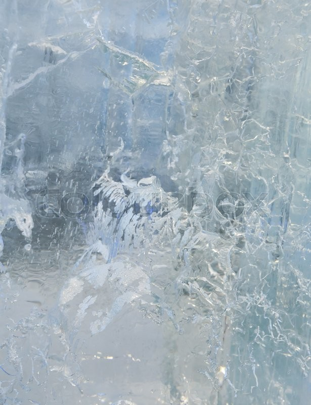 Stock image of 'Glacial transparent wall of ice with interesting drawings and patterns . Closeup, background.'