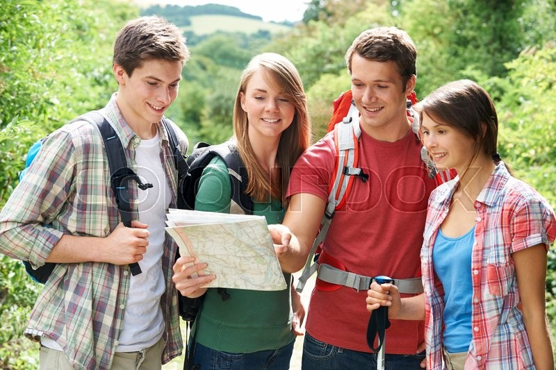 Stock image of 'Group Of Young Friends Hiking In the Countryside'