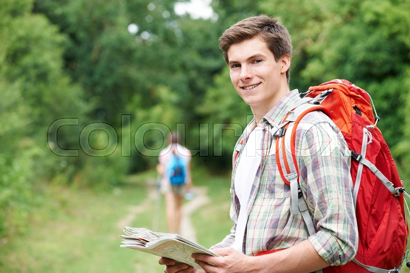 Stock image of 'Yoiung Couple Hiking In Countryside'
