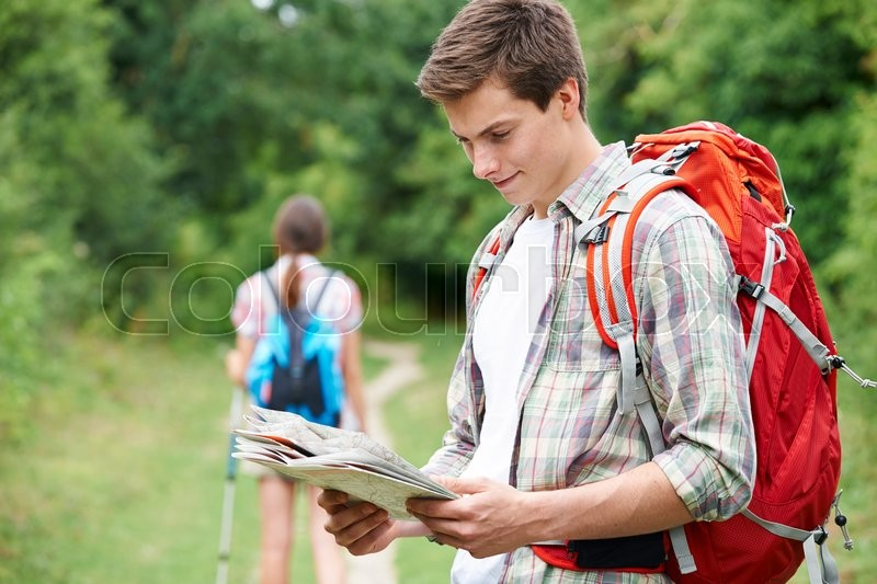 Stock image of 'Young Couple Hiking In Countryside'