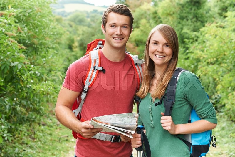 Stock image of 'Portrait Of Young Couple Hiking In Countryside'