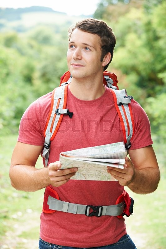 Stock image of 'Young Man On Hike Through Countryside'