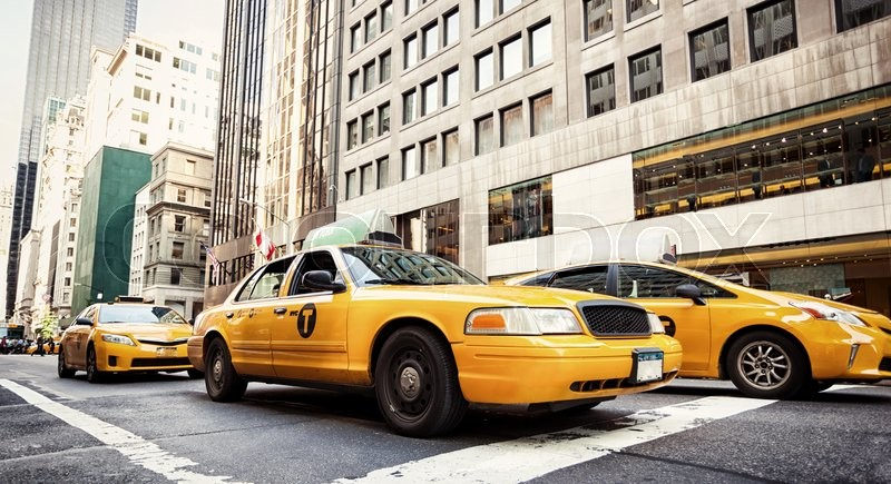 Stock image of 'Yellow cabs in Manhattan, NYC. The taxicabs of New York City are widely recognized icons of the city.'