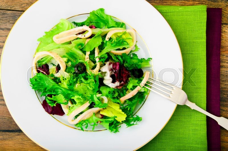 Stock image of 'Salad Mix Batavian, Frise, Radicchio, Chicory and Squid Dietary Meal'