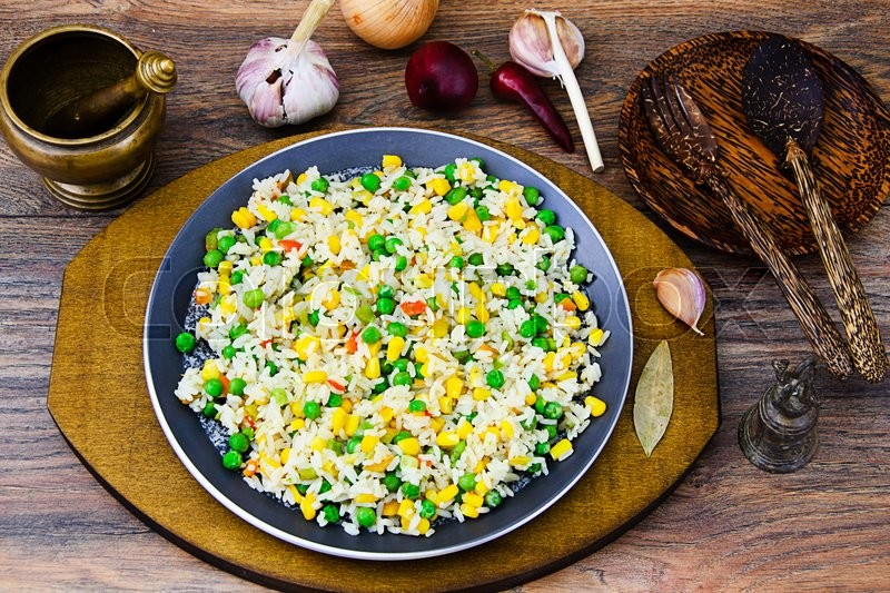 Stock image of 'Risotto with Vegetables and Peas. Studio Photo'