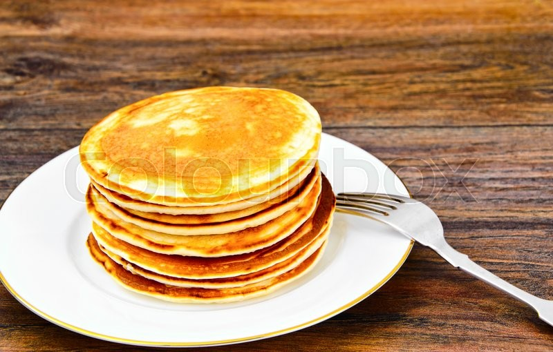 Stock image of 'Tasty Pancakes Stack on Plate Studio Photo'