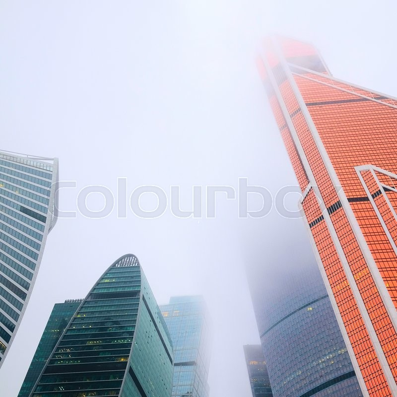 Stock image of 'Skyscrapers in a high mist'