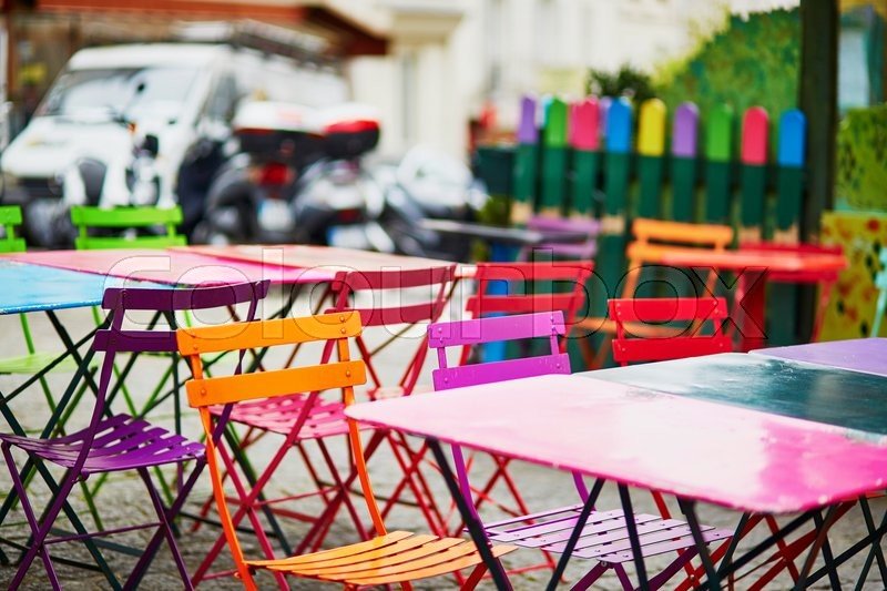 Stock image of 'Bright colorful tables of an empty Parisian outdoor cafe on Montmartre'