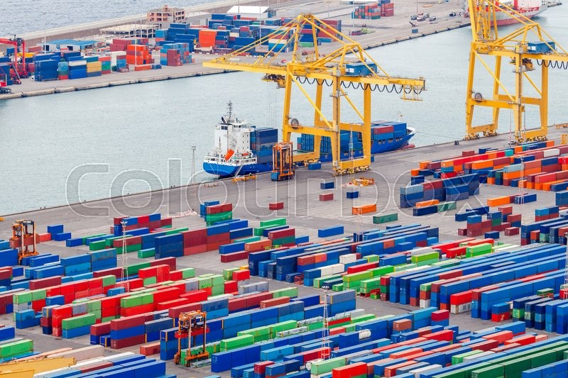 Stock image of 'View of the cargo port and container terminal of Barcelona with the Montjuic hill.'