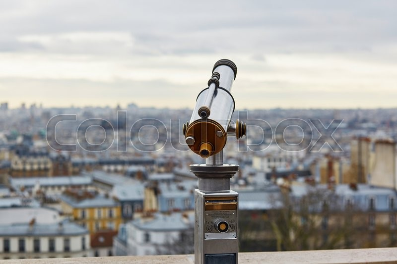 Stock image of 'Touristic telescope overlooking Montmartre hill with scenic city view in Paris, France'