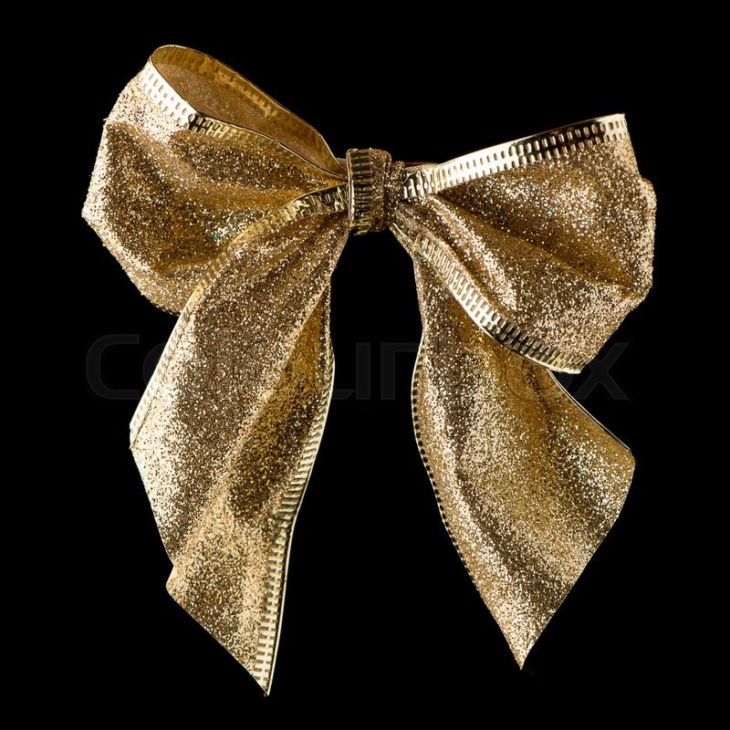 Stock image of 'Beautiful gold ribbon gift bow isolated on black background'