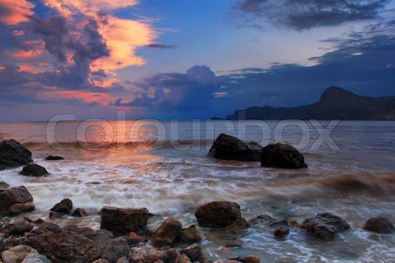 Stock image of 'Colorful sunset on the beach'