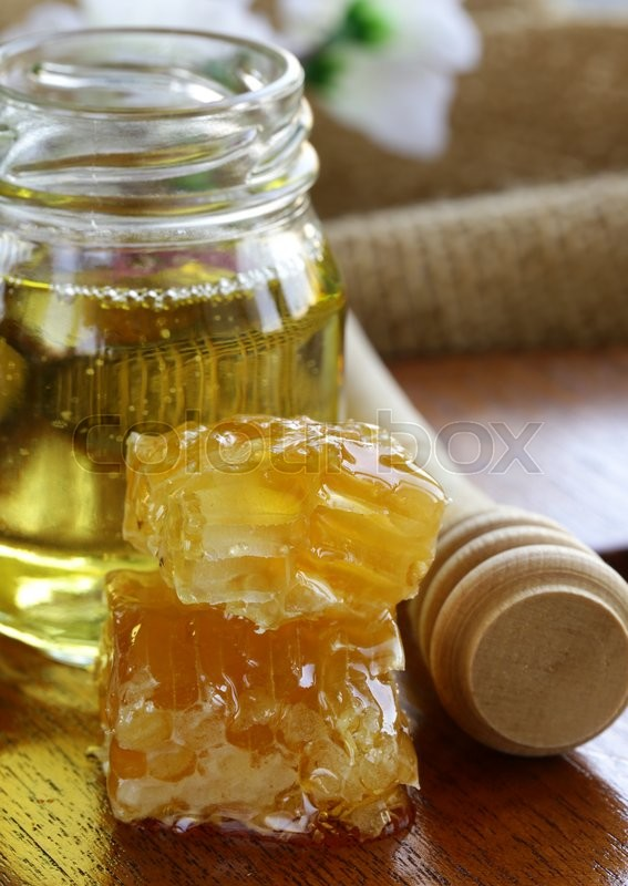 Stock image of 'natural organic honey in the comb and  glass jar'