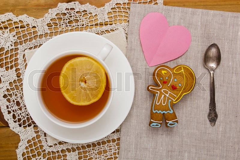 Stock image of 'Cookies with tea for Mom. Dedicated to all mothers.'