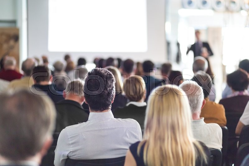 Speaker Giving a Talk at Business Meeting. Audience in the conference hall. Business and Entrepreneurship. , stock photo