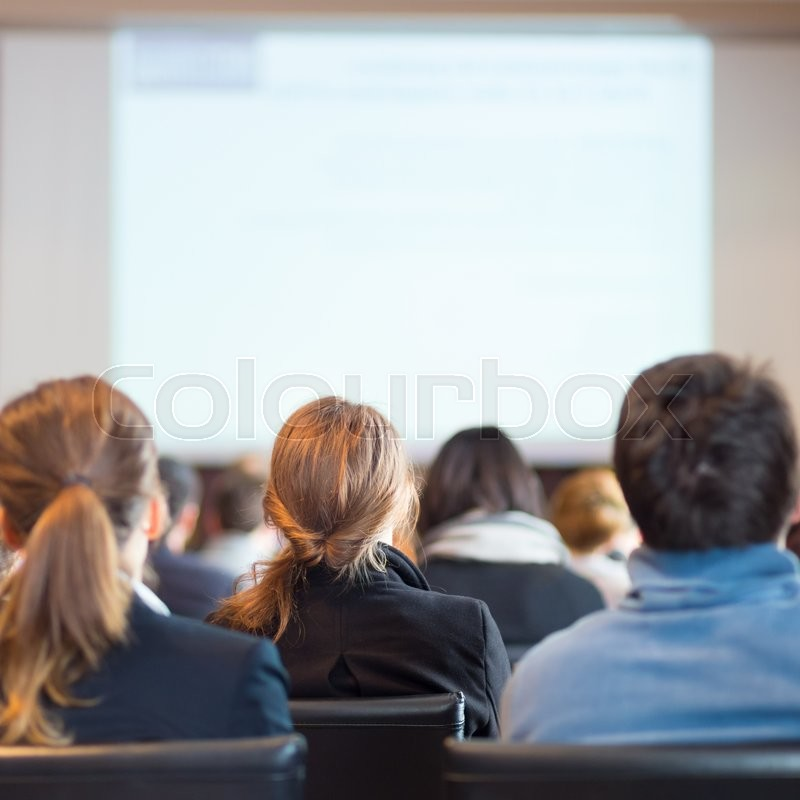 Stock image of 'Speaker Giving a Talk at Business Meeting. Audience in the conference hall. Business and Entrepreneurship. '