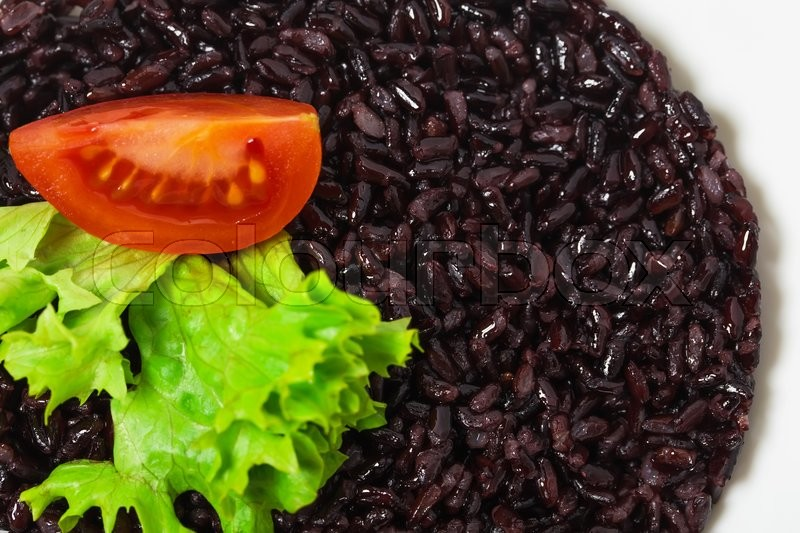 Stock image of 'Black rice risotto with tomato. As a whole background.'