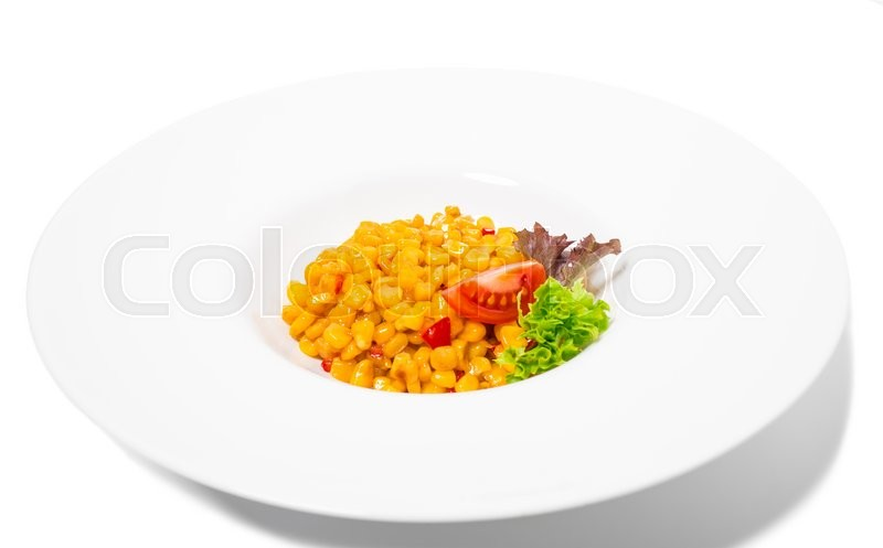 Stock image of 'Tasty roasted corn with paprika and lettuce. Isolated on a white background.'