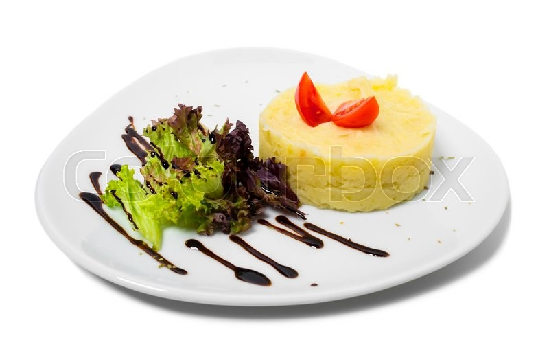 Stock image of 'Delicious mashed potatoes with tomatoes and lettuce. Isolated on a white background.'