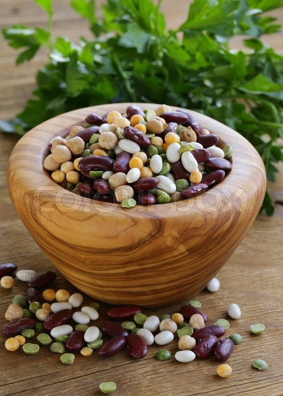 Stock image of 'Assortment of different types of beans - red beans, chickpeas, peas'