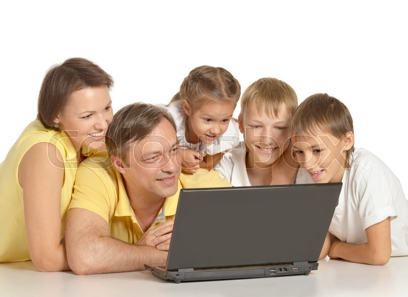 Stock image of 'Portrait of a cute happy family with laptop'