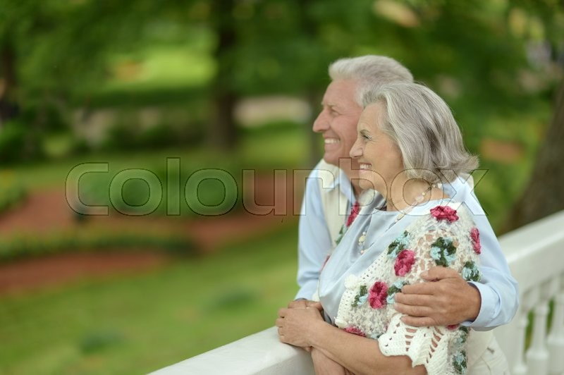 Stock image of 'Loving mature couple  in a summer park'