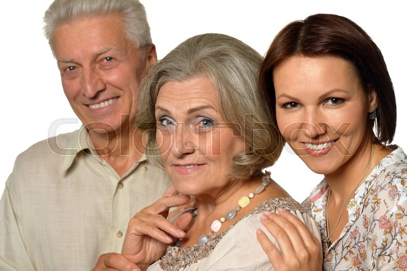 Stock image of 'Happy senior parents with daughter on background'