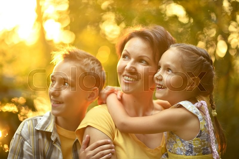 Stock image of 'Cute ,happy Mother with kids on the field'