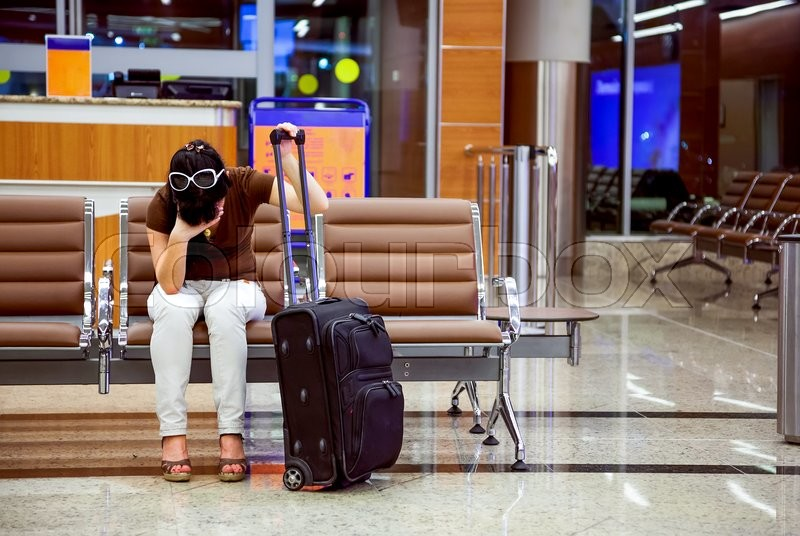 Stock image of 'woman was late for a plane at the airport'